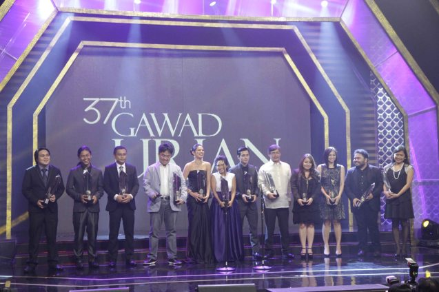 Awardees from left: Emerson Texon (Best Music--SONATA), Atty. Julius Matibag, creative consultant representing Adjani Arumpac (Best Documentary-NANAY MAMENG), Chuck Gutierrez (Best Editing- RIDDLES OF MY HOMECOMING), Best Supporting Actress Angel Aquino (ANG HULING CHACHA NI ANITA), Best Actress Angeli Bayani (NORTE HANGGANAN NG KASAYSAYAN), Best Supporting Actor Junjun Quintana (A PHILIPPINO STORY), Best Actor Joel Torre (OTJ), Best Director Hannah Espia (TRANSIT), Corinne de San Jose (Best Sound--OTJ), 2nd Assistant Director Lir dela Cruz and Line Producer Maya Quirino represented Lav Diaz as NORTE SA HANGGANAN NG KASAYSAYAN also won Best Picture, Best Screenplay (Lav Diaz and Rody Vera) and Best Cinematography (Lauro Rene Manda). The 37th Gawad Urian Awards was held at the Dolphy Theater last June 17, 2014. Photo by Jude Bautista.