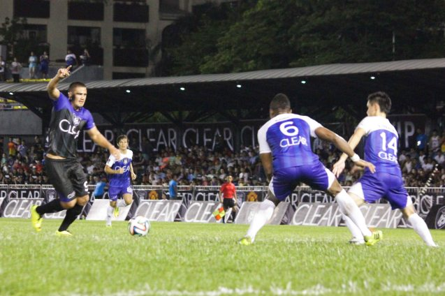 TEAM PHIL's Matthew Hartmann gets inside of TEAM JAMES defense. THE CLEAR DREAM MATCH was held at the sold out University of Makati Stadium last June 7, 2014. Photo by Jude Bautista