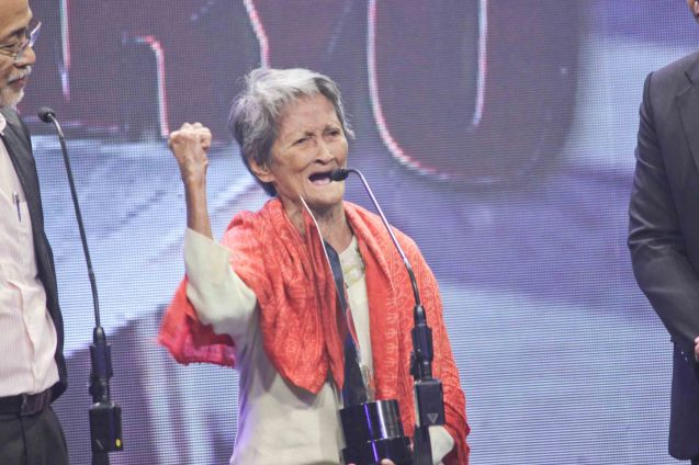 Carmen Deunida is NANAY MAMENG who had the most emotional speech. She accepted the award for BEST DOCUMENTARY (NANAY MAMAENG) for filmmaker Adjani Arumpac who based it on her life as an 86-year-old activist and organizer of women's group Samahan ng Maralitang Kababaihang Nagkakaisa (Samakana). The 37th Gawad Urian Awards was held at the Dolphy Theater last June 17, 2014. Photo by Jude Bautista.