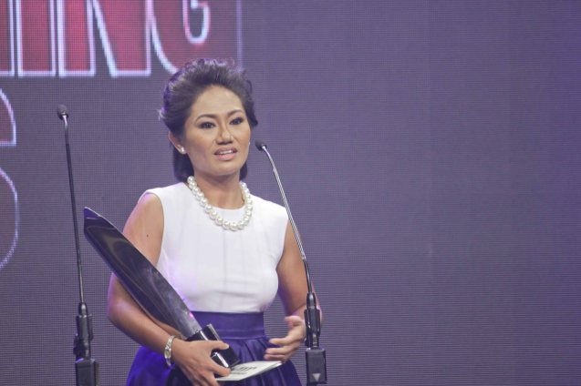 Best Actress Angeli Bayani (NORTE HANGGANAN NG KASAYSAYAN) is still in disbelief as she receives the award. The 37th Gawad Urian Awards was held at the Dolphy Theater last June 17, 2014. Photo by Jude Bautista.