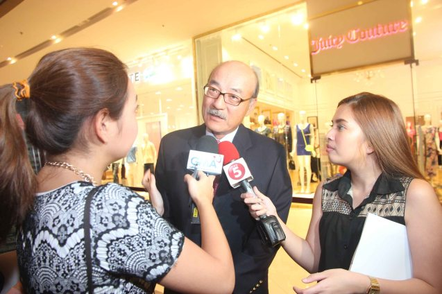 (center) Japan Amb H.E. Toshinao Urabe was interviewed from left by GMA News' Cata Inocencio and TV5 Aksyon Anne Cabral. Photo was taken at the Shang East Wing where the opening of Eiga Sai fest was held. The Eiga Sai Japanese Film Festival will screen films for free run from July 4 to 13, 2014 at the Shang Cineplex, Shang Rila Plaza Mall. Photo by Jude Bautista