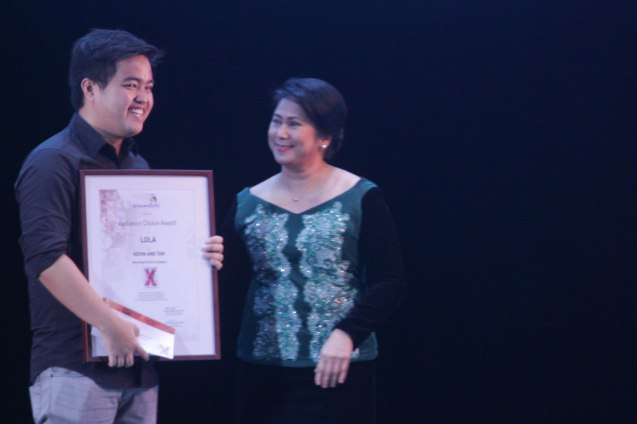 Kevin Ang (LOLA) receives Audience Choice Award- Short film from CHILDREN'S SHOW Producer/actress Suzette Ranillo during the Cinemalaya X Awards last August 10, 2014 at the CCP. Watch out for Cinemalaya films' commercial release in the coming months. Photo by Jude Bautista