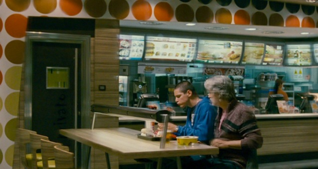 left: Filippo Scicchitano (Luca)  and Fabrizio Bentivoglio (Bruno) their first meal together is in fast food. Cine Europa will screen SCIALLA and the best European movies for free at Shang Cineplex, Shang Rila Plaza from September 11-21, 2014.