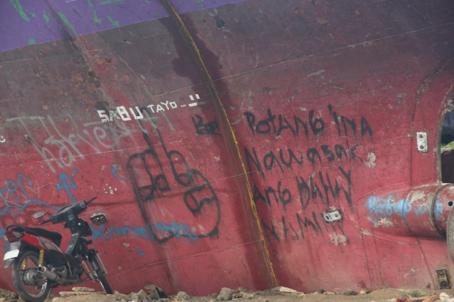 Graffiti on ship that was tossed on shore during storm surge says it all. Photo by Jude Bautista