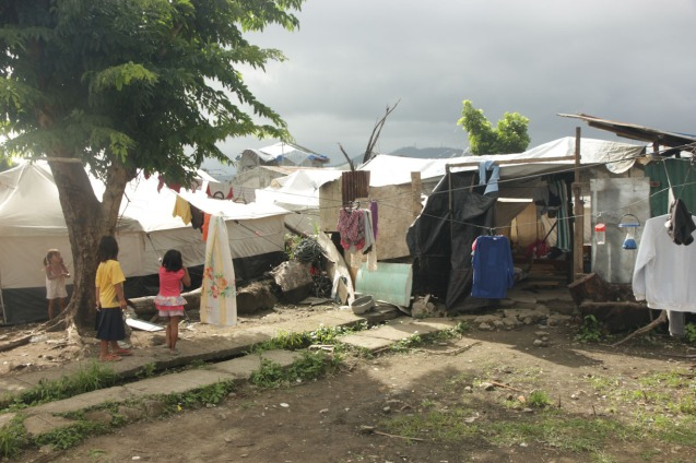 Nearly a year later, people still live in tents in Tacloban a similar situation in Zamboanga. Photo by Jude Bautista