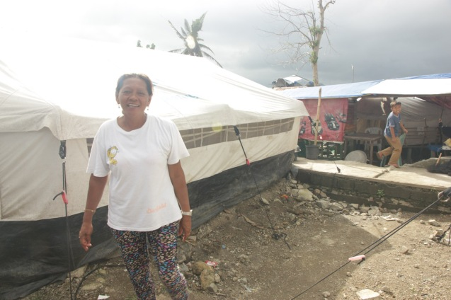 Nearly a year later, people still live in tents in Tacloban. Photo by Jude Bautista