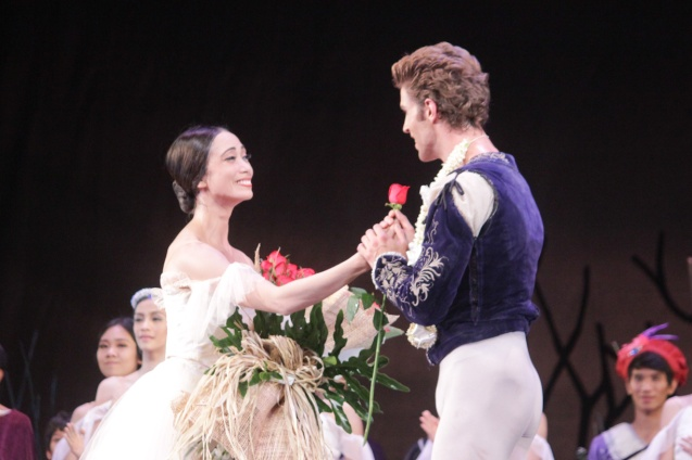 Stella Abrera (Giselle) gives partner James Whiteside (Albrecht) a rose. Ballet Philippines' 45th year was celebrated with a special staging of GISELLE from September 19, 20 & 21, 2014 at the CCP Tanghalang Nicanor Abelardo. Photo by Jude Bautista