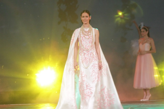 Jo Ann Bitagcol (Model and photographer) in Rhett Eala creation on the ramp for Jewelmer 35th, Miracle of the Golden Pearl September 23, 2014. Photo by Jude Bautista
