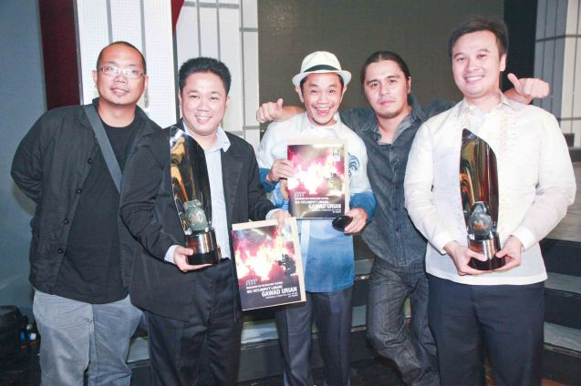 from left AMOK team: Writer Paul Sta. Ana, John Bedia, Best Supporting actor nominee Garry Lim and director / Best Editing awardee Lawrence Fajardo, with Best Picture awardee Producer Alemberg ANG ANG SAYAW NG DALAWANG KALIWANG PAA. Photo was taken during the 35th Gawad Urian awards night last June 13, 2012 at the AFP Theater. Photo by Jude Bautista