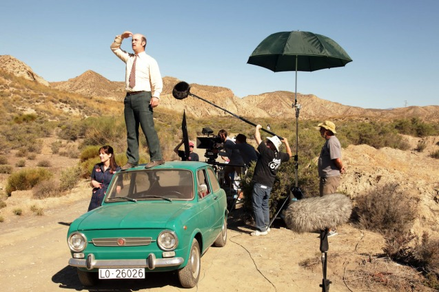 Javier Camara (Antonio) climbs his car to get a glimpse of John Lennon. VIVIR ES FACIL CON LOS OJOS CERRADOS (LIVING IS EASY WITH EYES CLOSED) is one of many films in the PELICULA Spanish film festival running from October 9-19, 2014 at the Greenbelt Cinemas.