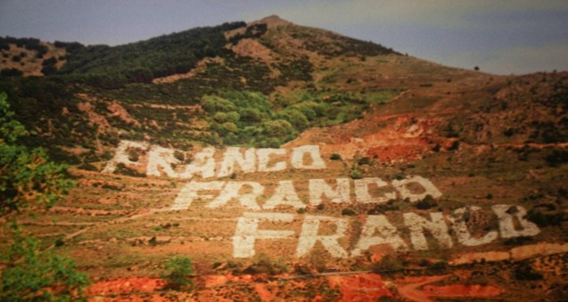 Dictator Francisco Franco's name on side of a hill- conservatism pervaded Spanish Culture during his reign. VIVIR ES FACIL CON LOS OJOS CERRADOS (LIVING IS EASY WITH EYES CLOSED) is one of many films in the PELICULA Spanish film festival running from October 9-19, 2014 at the Greenbelt Cinemas.