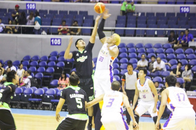 Tip off from right: NLEX Road Warriors (Asi Taulava) and Global Port Batang Pier (Yancy De Ocampo). Catch PBA games live in SMART ARANETA Coliseum. If not you can watch the PBA's 40th season live airing on TV5 five times a week on TUES, WED and FRI, with the first game at 4:15 p.m. and the second game at 7 p.m.; on SAT at 5 p.m.; and SUN at 3 p.m. and 5 p.m. Photo by Jude Bautista