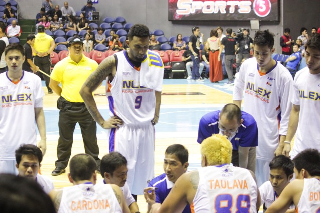 NLEX acting head Coach Adonis Tierra was calling the shots in the huddle early in the 1st quarter. Catch PBA games live in SMART ARANETA Coliseum. If not you can watch the PBA's 40th season live airing on TV5 five times a week on TUES, WED and FRI, with the first game at 4:15 p.m. and the second game at 7 p.m.; on SAT at 5 p.m.; and SUN at 3 p.m. and 5 p.m. Photo by Jude Bautista