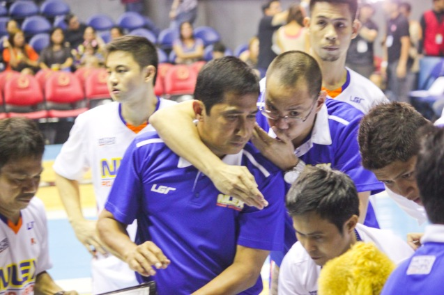 From left: NLEX acting head Coach Adonis Tierra confers with Asst coach Sandy Arespacochaga. Catch PBA games live in SMART ARANETA Coliseum. If not you can watch the PBA's 40th season live airing on TV5 five times a week on TUES, WED and FRI, with the first game at 4:15 p.m. and the second game at 7 p.m.; on SAT at 5 p.m.; and SUN at 3 p.m. and 5 p.m. Photo by Jude Bautista