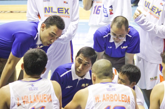 NLEX acting head Coach Adonis Tierra was calling the shots in the huddle early in the 1st quarter with him are from left: Asst Coaches Ford Arao and Sandy Arespacochaga. Catch PBA games live in SMART ARANETA Coliseum. If not you can watch the PBA's 40th season live airing on TV5 five times a week on TUES, WED and FRI, with the first game at 4:15 p.m. and the second game at 7 p.m.; on SAT at 5 p.m.; and SUN at 3 p.m. and 5 p.m. Photo by Jude Bautista