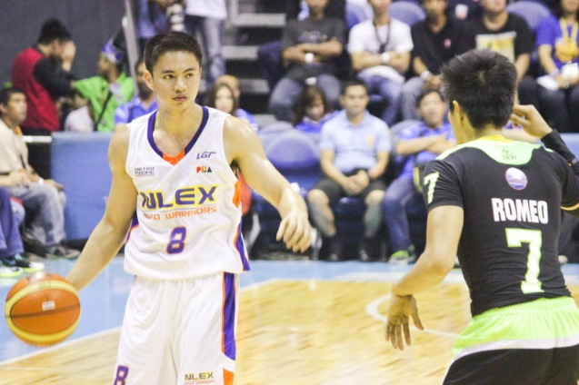 NLEX Road Warrior John Raymundo calls play with Batang Pier Terrence Romeo guarding him. Catch PBA games live in SMART ARANETA Coliseum. If not you can watch the PBA's 40th season live airing on TV5 five times a week on TUES, WED and FRI, with the first game at 4:15 p.m. and the second game at 7 p.m.; on SAT at 5 p.m.; and SUN at 3 p.m. and 5 p.m. Photo by Jude Bautista