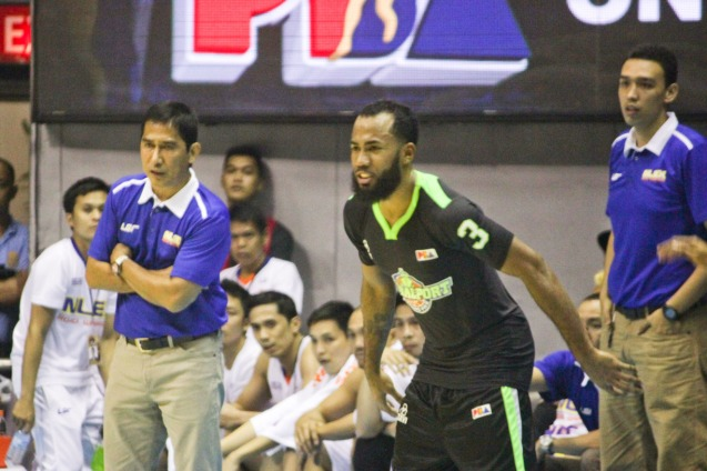 Global Port Batang Pier Stanley Pringle inbounds ball in front of NLEX coaches Adonis Tierra and Ford Arao. Catch PBA games live in SMART ARANETA Coliseum. If not you can watch the PBA's 40th season live airing on TV5 five times a week on TUES, WED and FRI, with the first game at 4:15 p.m. and the second game at 7 p.m.; on SAT at 5 p.m.; and SUN at 3 p.m. and 5 p.m. Photo by Jude Bautista
