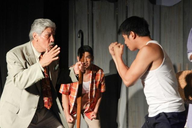 from left: Ding Navasero (Ben) dares Yul Servo (Biff). PAHIMAKAS SA ISANG AHENTE (DEATH OF A SALESMAN) of Tanghalang Pilipino runs from September 26 to October 19, 2014 at the Tanghalang Huseng Batute Theater, CCP. Photo by Jude Bautista