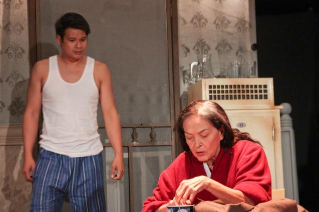 Yul Servo (Biff) & Gina Pareño (Linda). PAHIMAKAS SA ISANG AHENTE (DEATH OF A SALESMAN) of Tanghalang Pilipino runs from September 26 to October 19, 2014 at the Tanghalang Huseng Batute Theater, CCP. Photo by Jude Bautista