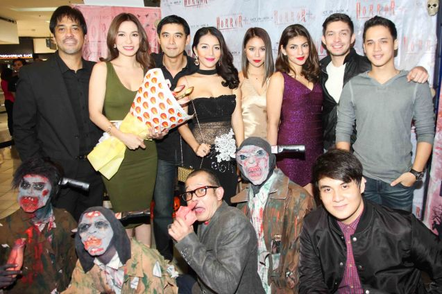 standing from left: Alvin Anson (Cong. Calipes), Regine Angeles (Slavacion), Robert Kuan (Albert), China Roces (Robina), Glea Burbano (Fern), Marga Yabes (Clarissa), David Karell (Xander) and Kevin Rivas (Rain). Foreground right Mavi Lozano (Marcus), & Hero Bautista (Direk Allan G. Pangalan). Catch the HORROR PLUS Film Fest from October 29-Nov.14, 2014 at SM Cinemas. Photo by Jude Bautista