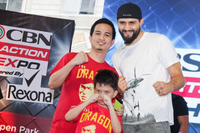 UFC star Carlos Condit meets super fan Ari & son Red Repalda. The first ever ABS CBN Sports & Action- Rexona Fight Expo was held last November 8, 2014 at the Eastwood City Open Area. Photo by Jude Bautista