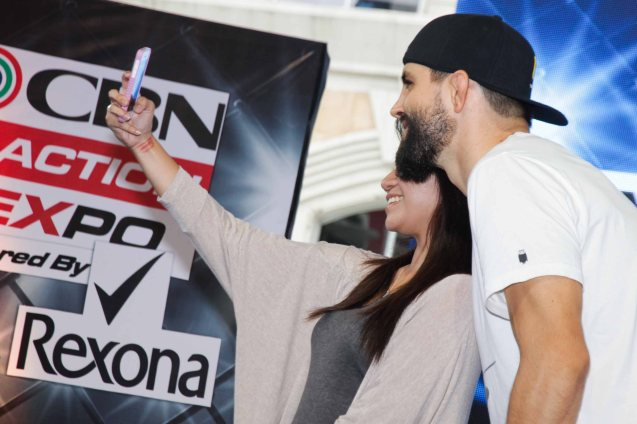 Condit poses with Pinay fan who shoots a selfie. The first ever ABS CBN Sports & Action- Rexona Fight Expo was held last November 8, 2014 at the Eastwood City Open Area. Photo by Jude Bautista