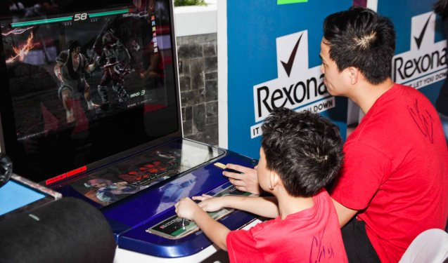 UFC Father and son super fans Ari & Red Repalda play Tekken 6 for free at the first ever ABS CBN Sports & Action- Rexona Fight Expo. It was held last November 8, 2014 at the Eastwood City Open Area. Photo by Jude Bautista