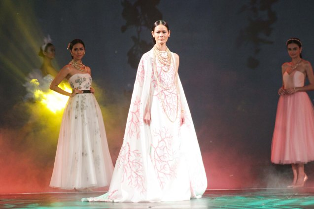 Jo Ann Bitagcol (Model and photographer) in Rhett Eala creation on the ramp for Jewelmer 35th, Miracle of the Golden Pearl September 23, 2014. CATCH a feature on Jo Ann this Sunday Nov 9, 2014 -- 7PM on CNN Phils (formerly 9TV/ SOLAR News Channel). Photo by Jude Bautista