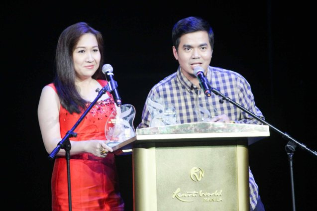 Universal Records General Mgr Kathleen Dy Go and Gloc 9 Album of the year (LIHAM AT LIHIM), Song of the Year (MAGDA featuring Rico Blanco), Best Collaboration Performance (MAGDA featuring Rico Blanco) and Best Rap (MAGDA). The 27th Awit Awards was held at the Newport Performing Arts Theater, Resort's World Manila last December 12, 2014. Photo by Jude Bautista