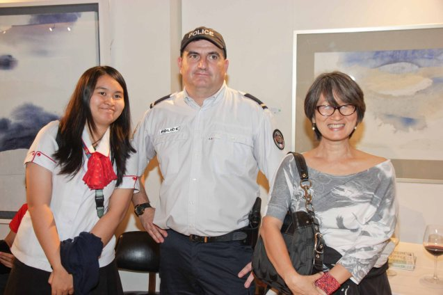 from right: PDI reporter Veronica Uy, French Security Attaché Arnaud Salingue, and Patricia Vitug during the candle lighting ceremony for the victims of the Charlie Hebdo attack held at Alliance Francaise de Manille last Januarry 14, 2015. Photo by Jude Bautista