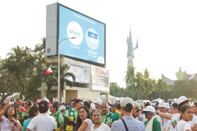Upon Pope Francis's arrival January 15, 2015, I belatedly decided to shoot him passing by on the Roxas Blvd and Vito Cruz. Because of the crowds all I could shoot well is the Video wall in front of CCP. Photo by Jude Bautista