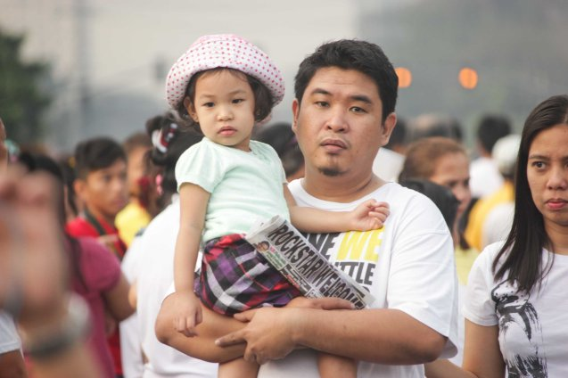 Father and daughter wait for Pope Francis to pass by across Plaza Dilao, Quirino Ave, Paco Manila last January 16, 2015. Photo by Jude Bautista