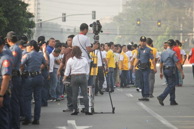 GMA Network Reporter Sherrie Ann Torres w TV crew set up, Plaza Dilao, Quirino Ave, Paco Manila last January 16, 2015. Photo by Jude Bautista