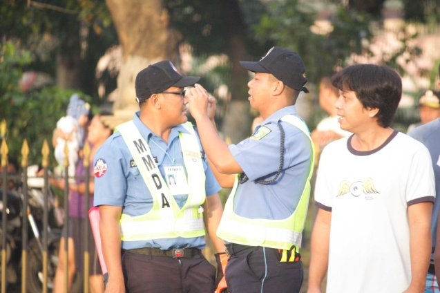 MMDA officer shoots historic scene with cell phone Quirino Ave, Paco Manila last January 16, 2015. Photo by Jude Bautista