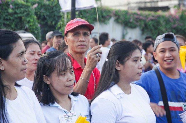PCA Headwaiter Domingo behind human barricade Quirino Ave, Paco Manila last January 16, 2015. Photo by Jude Bautista