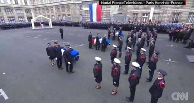 French President François Hollande posthumously gave the Legion d'Honneur to Ahmed Merabet, Jean-Philippe and Franck Brinsolaro, laying medals on the coffins of all three slain police officers. http://edition.cnn.com/2015/01/13/europe/charlie-hebdo-france-attacks/