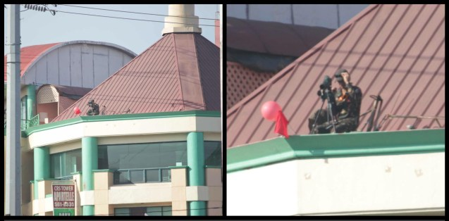 PNP Sniper on roof (left photo) checks out other elevated areas w Binoculars (right close up pic); Quirino Ave, Paco Manila last January 16, 2015. Photo by Jude Bautista
