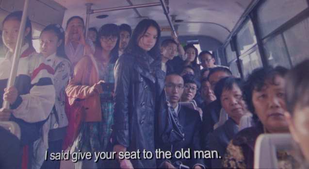 commuters stare down Ye Lanqiu in bus. Watch CAUGHT IN THE WEB and other Chinese films for free in Spring Film Festival at Shang Cineplex, Shang Rila Plaza Mall from Feb 13-22, 2015.
