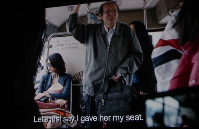 Ye Lanqiu (Yuan Yuan Gao) refuses to give her seat to old man (Bao Hua Chang). Watch CAUGHT IN THE WEB and other Chinese films for free in Spring Film Festival at Shang Cineplex, Shang Rila Plaza Mall from Feb 13-22, 2015.
