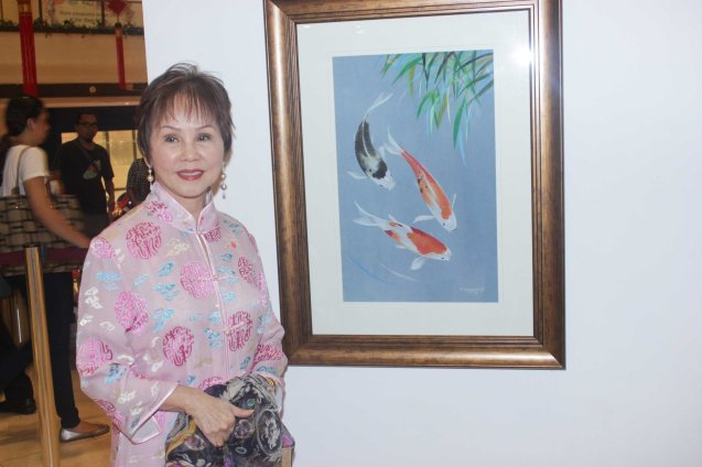 Dr. Rosita Leong poses by the work of Fidel Sarmiento who has a new approach to Chinese painting. This is one of many works you can see at the Chinese painting Exhibit in Shang Plaza mall from February 12-20, 2015. Photo by Jude Bautista