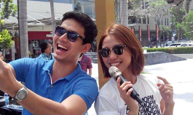 Christian Bautista shoots selfie w Aicelle Santos. Photo from Official OPM facebook page. PALAKASIN ANG OPM COLLAB Sessions first 12-hour OPM festival was held at the Bonifacio High Street Amphitheatre, Bonifacio Global City Taguig last March 14, 2015.