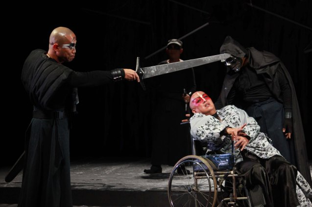 from left: Renante Bustamante (Duke ng Albanya) & George De Jesus III (Regan) in wheelchair while Nico Dans (Death) looks over her. Studio Connection's HARING LEAR can be seen at the CSB SDA Theater from February 27 to March 8, 2015. HARING LEAR is also part of the FRINGE MANILA Multi arts festival. Photo by Jude Bautista