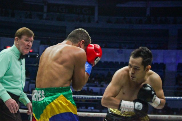 Donaire pours on uppercuts as Prado turtles up. PINOY PRIDE 30 D-Day was held at the SMART Araneta Coliseum last March 28, 2015. Photo by Jude Bautista