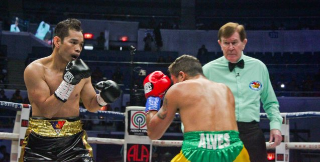 Ref Mctavish sees the damage suffered by Prado. PINOY PRIDE 30 D-Day was held at the SMART Araneta Coliseum last March 28, 2015. Photo by Jude Bautista