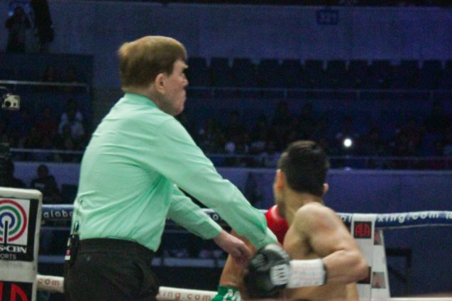 Ref McTavish has seen enough & stops the fight at the 2:16 mark of the 2nd round. PINOY PRIDE 30 D-Day was held at the SMART Araneta Coliseum last March 28, 2015. Photo by Jude Bautista