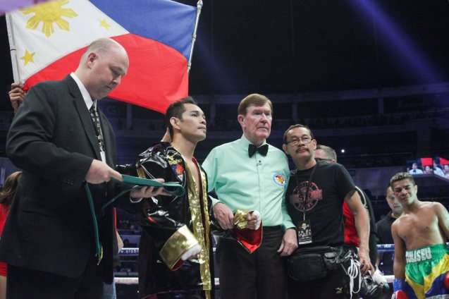 right: Prado smirks as ref Mctavish prepares to raise Nonito Donaire Jr's hand. PINOY PRIDE 30 D-Day was held at the SMART Araneta Coliseum last March 28, 2015. Photo by Jude Bautista