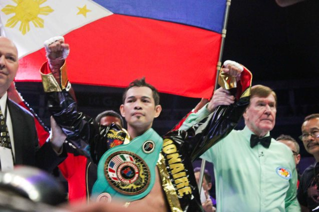 Nonito Donaire Jr raises his hand in victory and earns vacant NABF Super Bantamweight Belt. PINOY PRIDE 30 D-Day was held at the SMART Araneta Coliseum last March 28, 2015. Photo by Jude Bautista