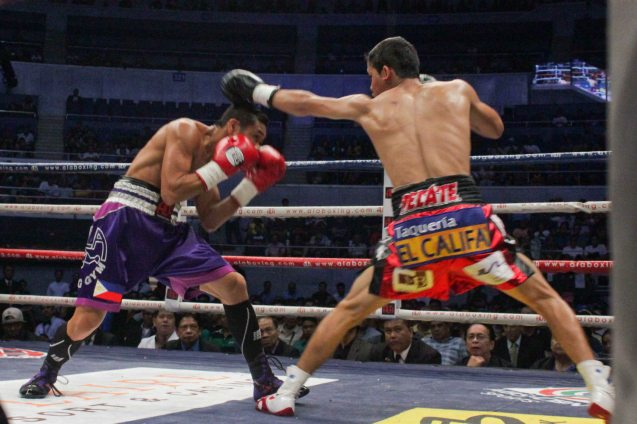Gilberto Parra lands jab; PINOY PRIDE 30 D-Day was held at the SMART Araneta Coliseum last March 28, 2015. Photo by Jude Bautista