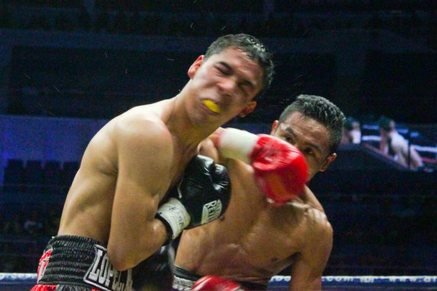 Donnie Nietes lands vicious overhand right and snaps Parra's head back. PINOY PRIDE 30 D-Day was held at the SMART Araneta Coliseum last March 28, 2015. Photo by Jude Bautista