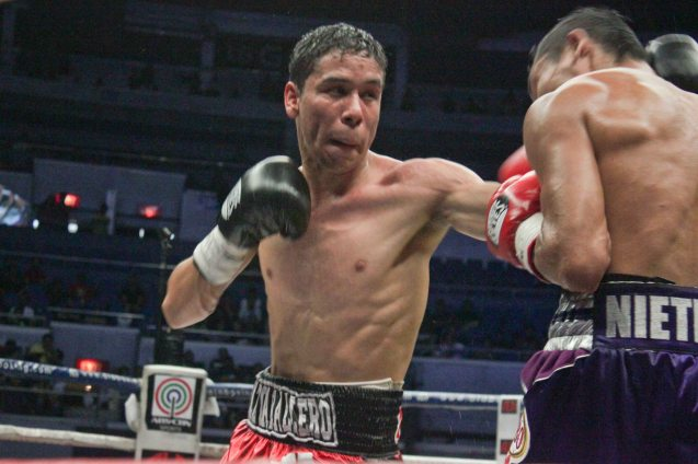 Parra tries to fight back w left jab; PINOY PRIDE 30 D-Day was held at the SMART Araneta Coliseum last March 28, 2015. Photo by Jude Bautista